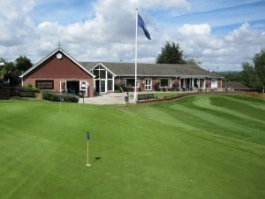 One of our three Putting Greens and the Clubhouse